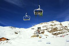 Mountains lift. Winter skiing time and travel in Alps royalty free stock image