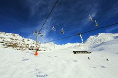 Mountains lift. Winter skiing time and travel in Alps royalty free stock images