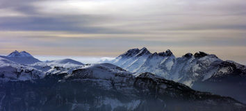 Mountains with lighting fog. Aravis mountains within strange lighting cclouds Royalty Free Stock Photos