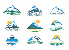 Mountains logo set. Mountain peak landscape with snow cover emblems vector illustration Royalty Free Stock Photography
