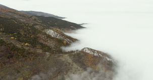 Mountains With A Lot Of Mist. Fly Over Mountains With A Lot Of Mist stock video footage