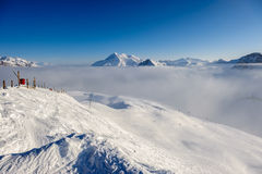 Mountains in low clouds with snow in winter Stock Images