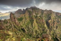 The mountains of Madeira with clouds. Beautiful panorama view of the landscape in the mountains of Madeira at Pico do Areeiro Arieiro, while hiking to Pico Ruivo stock photos