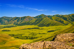 Mountains and meadow landscape Stock Images
