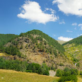 mountains, meadows and blue sky Royalty Free Stock Photography