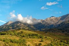 Mountains and meadows on the island Crete, Greece. Panoramic view of the mountains and meadows on the island Crete, Greece royalty free stock images