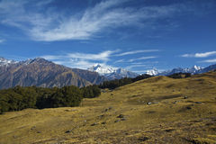 Mountains & meadows. Panoramic view of mountains, sky and meadows Stock Image
