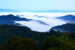 Mountains in the mist. View of far away blue mountains in the fog, it look like the sea, Thailand Stock Photo