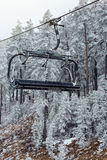Mountains with modern ski lift chair. In winter Royalty Free Stock Photography