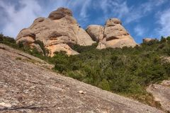 Mountains in Montserrat in Catalonia of Spain in a sunny day. Very interesting shape rocks.  royalty free stock photo