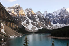 Mountains and moraine lake Stock Images