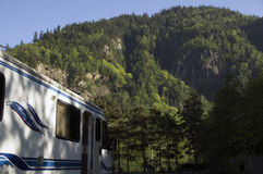 Mountains motorhome. Mountains with trees and a motor home in the foreground at a rest stop in British Columbia, Canada stock images