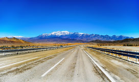 Mountains and motorway in Iran. With blue sky royalty free stock images