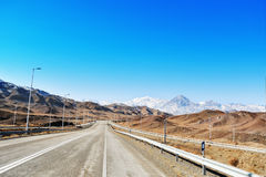 Mountains and motorway in Iran. With blue sky stock images
