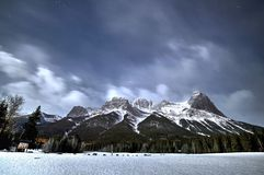 Mountains at night in Canmore. A beautiful night mountain scene in Canmore, Alberta with stars and snow capping the rockies Royalty Free Stock Photo