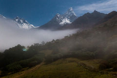 Mountains night fog, Tengboche village, Nepal. Stock Image
