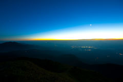 Mountains Night,Jungle towns,sky,Sunset,moonlight Stock Photos
