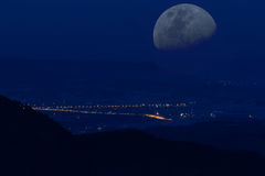 Mountains night valley moon royalty free stock photography