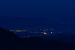 Mountains night valley towns Royalty Free Stock Photography