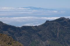 Mountains, ocean, clouds and at the background the island Tenerife Royalty Free Stock Photos