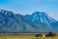 Mountains with old farmhouse and barn in foreground Royalty Free Stock Image