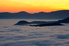 Mountains over the fog Stock Photography