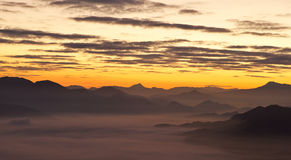 Mountains over the fog Royalty Free Stock Image