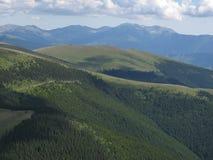 Mountains over mountain. View form Sureanu Mountains to Parang Mountains Stock Image