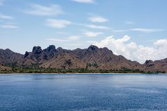 Mountains and Pacific Ocean, Komodo Island, Indonesia. Mountains and Pacific Ocean, Komodo, Lesser Sunda Islands, Indonesia Stock Images