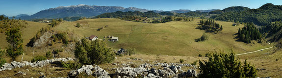 Mountains panorama. Isolated old chalets in romanian mountains Royalty Free Stock Photo