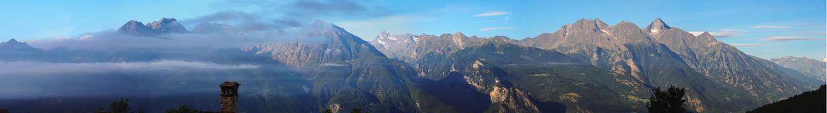 Mountains panorama. South view mountains range panorama with fog in valle d'aosta Italy Royalty Free Stock Photography