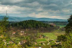 Mountains panorama in spring with village and meadows. Image was taken on April 2014 in Staniszow Poland Royalty Free Stock Images
