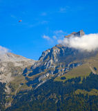 Mountains and paragliding. Titlis (Mount Titlis) elevation of 3020 meters, is located near Lucerne, Engelberg (Engelberg) area, built on a panoramic hilltop Royalty Free Stock Photography