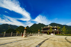 Mountains and park around long river. Blue sky with beautiful cloud.And green mountain around. Chinese style building inside Stock Image