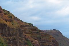 Mountains peak against cloudy sky. In Calheta on Portuguese island of Madeira royalty free stock image