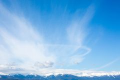 Mountains peaks and blue sky with clouds background Stock Image