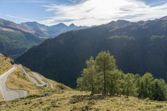 Mountains, peaks and trees landscape, natural environment. Timmelsjoch High Alpine Road. Passo del Rombo, the highest pass of the Eastern Alps. Ötztal stock photography