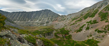 The mountains of the peninsula Kony. Panorama ridge of glacial valleys and glacial waterfall Stock Photo