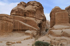 In the Mountains of Petra in Jordan. Mountains of Petra in Jordan against blue cloudy sky Stock Photos