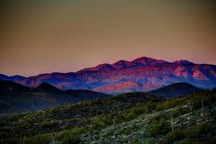 Mountains. Phoenix, Arizona - the last rays of a setting sun striking the mountains of the Sonoran desert in the evening royalty free stock photos