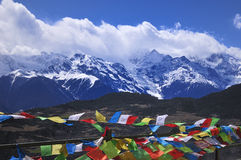 Mountains and prayer flags Stock Photos