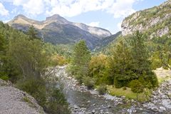 Mountains in the Pyrenees, a river and some trees Stock Photography