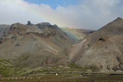 Mountains and rainbow in the Icelandic landscape Stock Photo