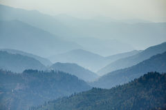 Mountains range in mist. At sunset Stock Photography