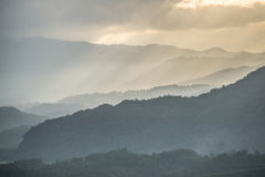 The mountains range in northern Thailand with the beautiful ray light. Royalty Free Stock Photos