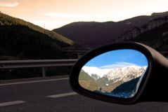 Mountains in the rear-view mirror Stock Photography