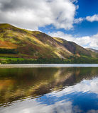 Reflections in Buttermere in Lake District. Mountains reflect into Buttermere calm lake in English Lake District Royalty Free Stock Photography