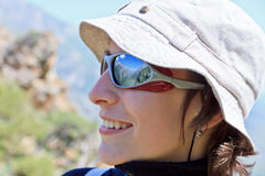 Mountains reflected in glasses on a girl Royalty Free Stock Photos