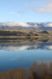 Mountains reflected in Lake Dunstan New Zealand. Pisa Range reflected in Lake Dunstan New Zealand Stock Photography