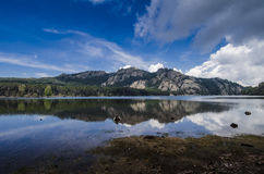 Mountains reflected in the lake water Stock Photography